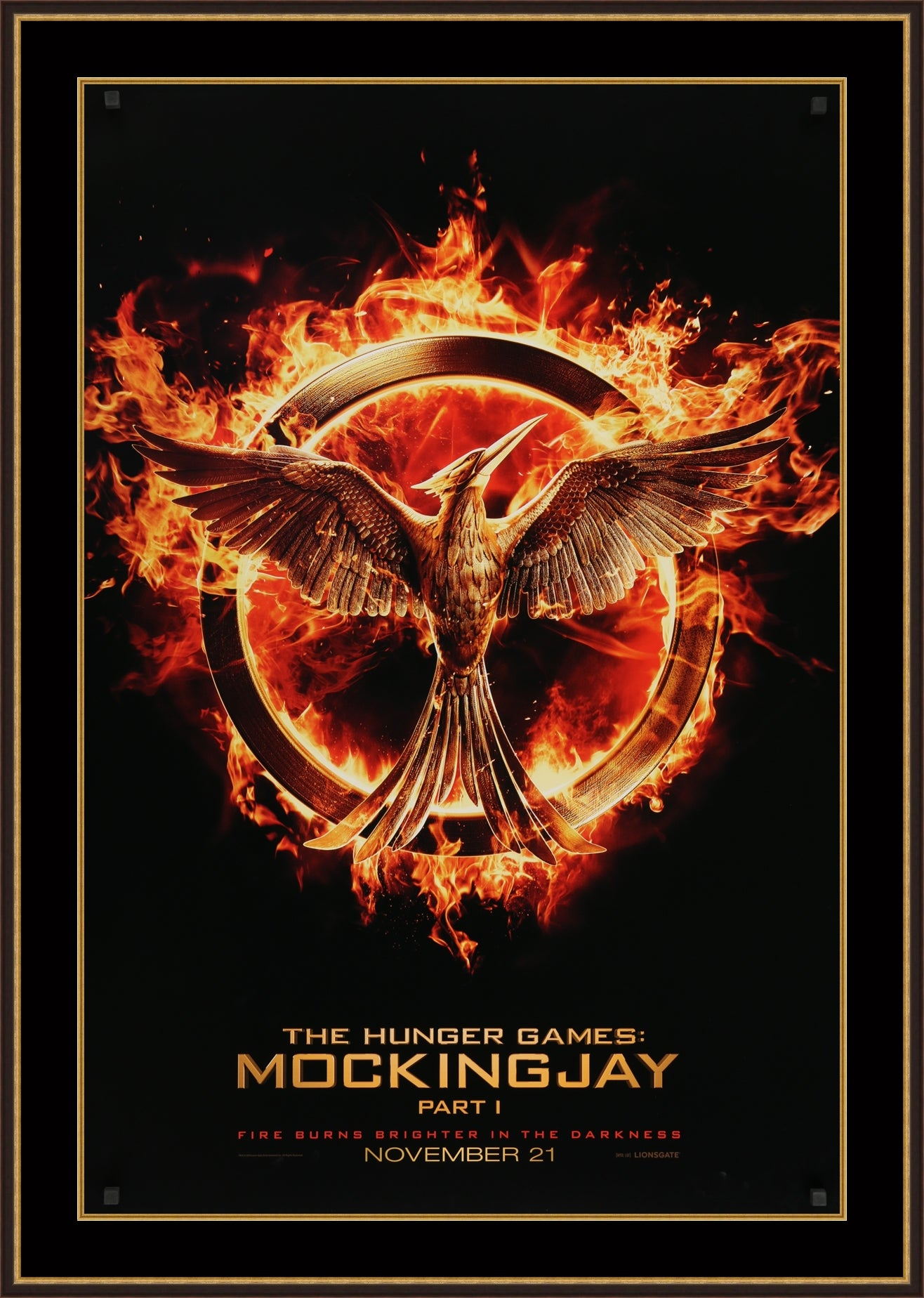An original movie poster for The Hunger Games: Mockingjay Part 1