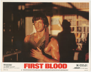 An original lobby card for the Sylvester Stallone film First Blood