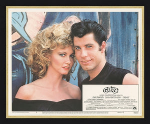An original lobby card for the musical film Grease