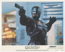 Load image into Gallery viewer, An original 11 x 14 lobby card for the film Robocop