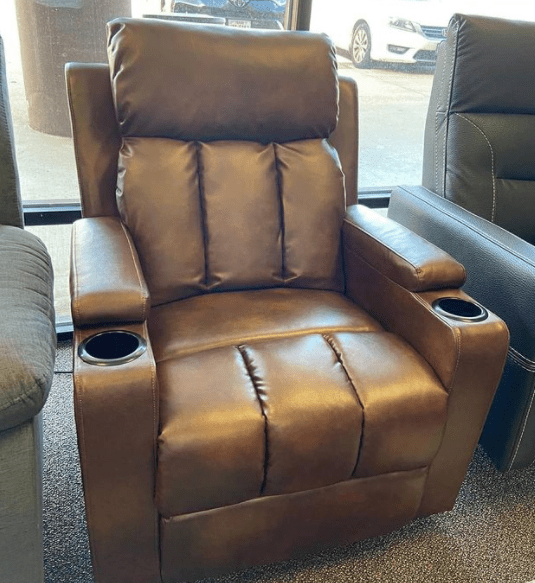 brown modern leather recliner chair with cupholders at ASY Furniture Houston store Instagram