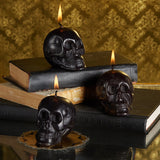 Twos Company Halloween String Lights and Triple Threat Black Skull 3 Pc. Candles Set