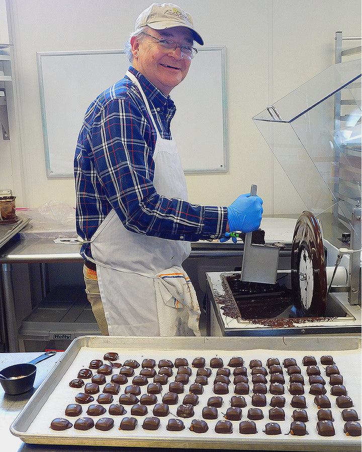 Stan Kitson, Chief Chocolatier at Driftless Chocolates, creating chocolates.