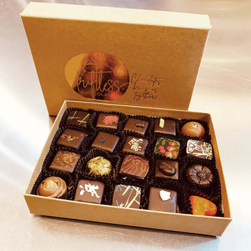 An assortment of fine chocolate truffles and bonbons in a 20-piece box