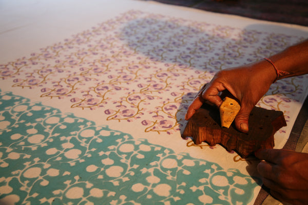 block printing process showing layers of color