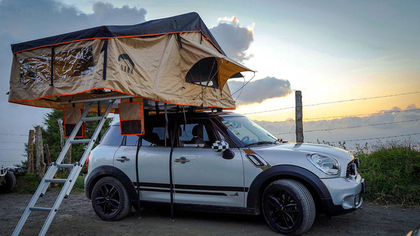 Wanaka 3 Person Roof Top Tent Setup With Annex on top of a mini cooper