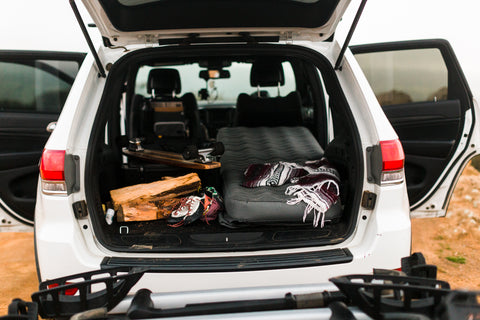 Pack all your camping essentials, including your camping air mattress, in your trunk before sleeping in your car on your next overlanding trip