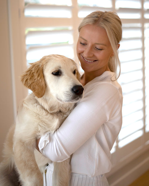 photo of Green Group Collective director Danielle Robinson holding her golden retriever dog Freddie