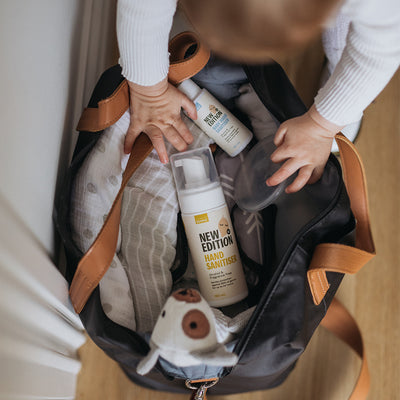 baby bag holding blankets, toys, Pumpd silicone breast pump and the New Edition NZ family sanitising pack, including adult hand sanitiser and baby hand sanitiser spray