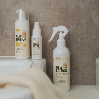 New Edition Hand And Surface Sanitising Pack including the adult foaming hand sanitiser, everything spray for surfaces and baby hand sanitiser spray all sitting by bathroom sink
