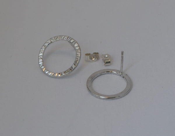 circle shaped hammered texture stud earrings one shown in the back to show the sterling silver post