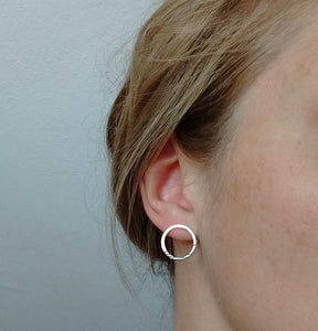 Sterling Silver Stud Style Geometric earrings in a circular shape with three black line details and a polished finish.