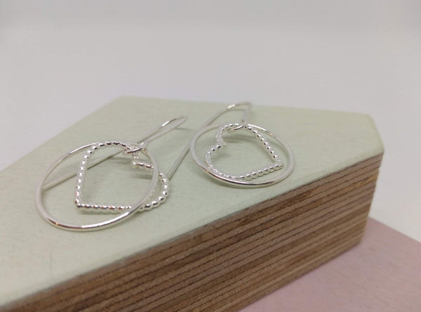 sterling silver drop dangly earrings with a circle and love heart shaped charm
