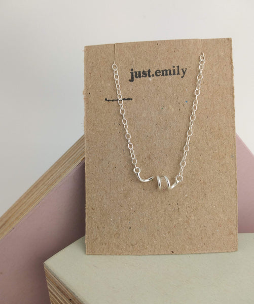 twist style bracelet in sterling silver displayed on recycled kraft card display