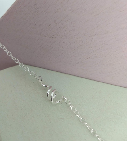 delicate sterling silver trace chain bracelet with twist design