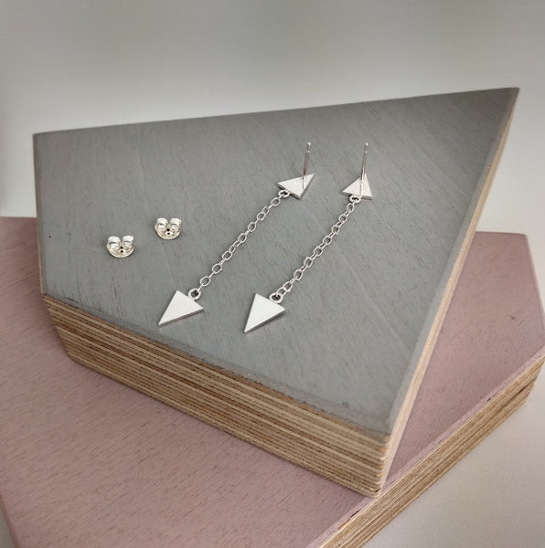 sterling silver gothic style double triangle earrings displayed on wooden block