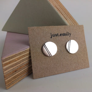 solid sterling silver stud earrings with double line detail in black displayed on recycled craft card
