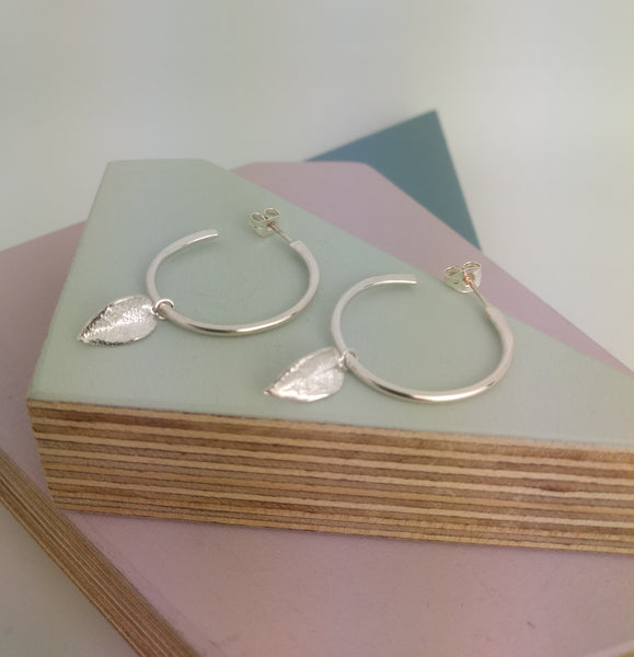 sterling silver earrings with hoop and leaf detail