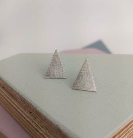 geometric triangle stud earrings with brushed surface texture