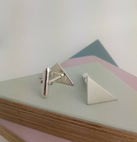 sterling silver cufflinks with triangle design from the front and back showing mechanism
