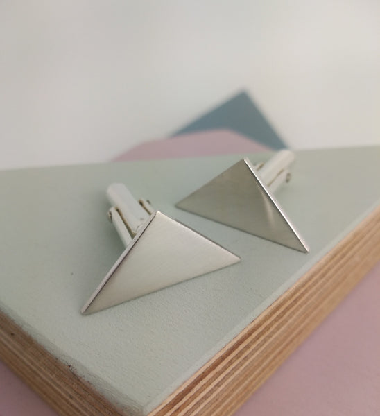 triangle shaped cufflinks with polished surface