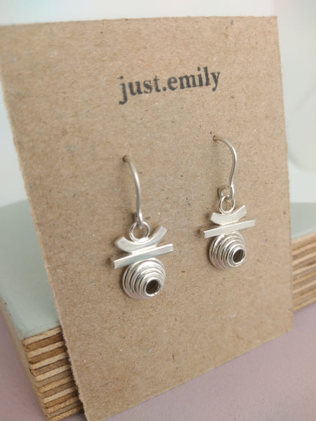 atzec style sterling silver drop earrings on display craft card