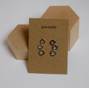 Sterling silver concentric circle drop style earrings on craft card display