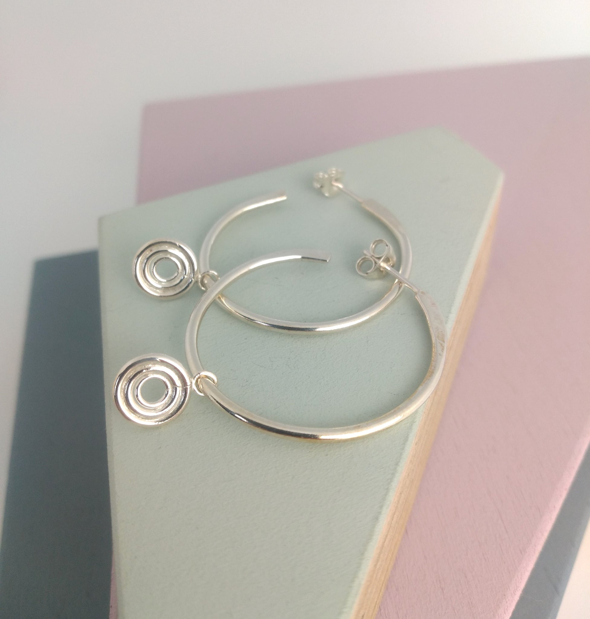 hoop earrings in sterling silver with circle charm