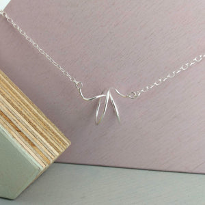 sterling silver twisted wire 'whisk' shaped necklace design
