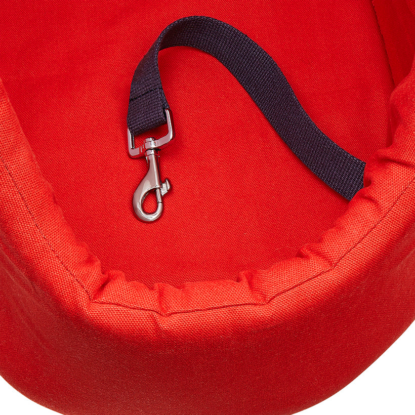red designer cotton pet carrier and dog travel day bed