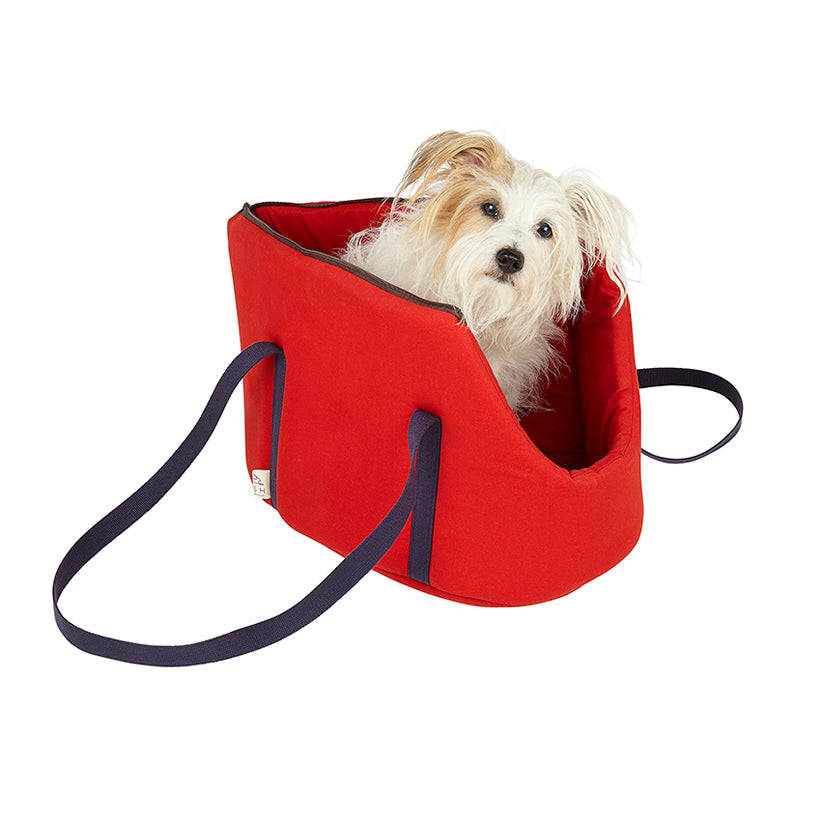 Jack Russell in red designer pet carrier hundred percent cotton and suitable for vegan dog owners