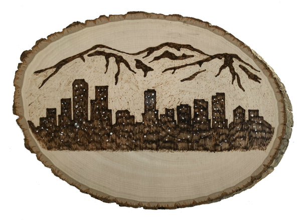 Beautiful city scape burnt into wood