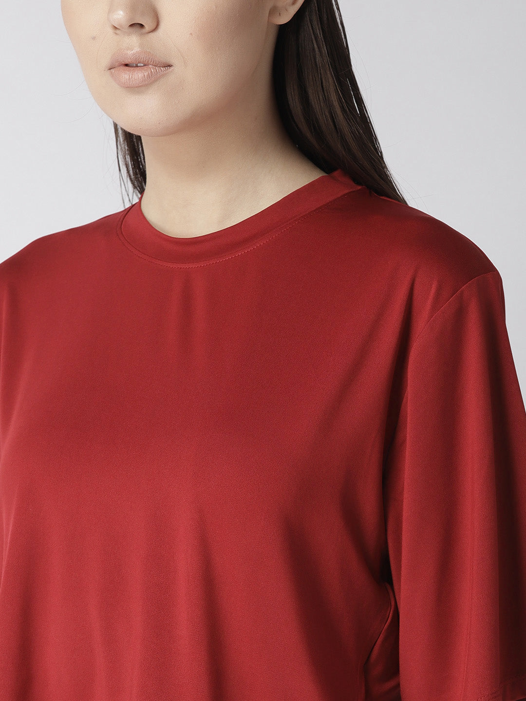 Fitkin Relaxed Fit Mid-length top with a mesh layering at the back.