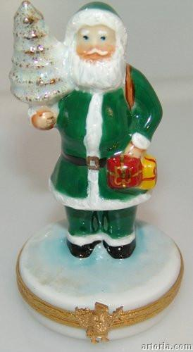 Santa in a green suit Limoges Boxes - Limoges Boxes Porcelain Figurines