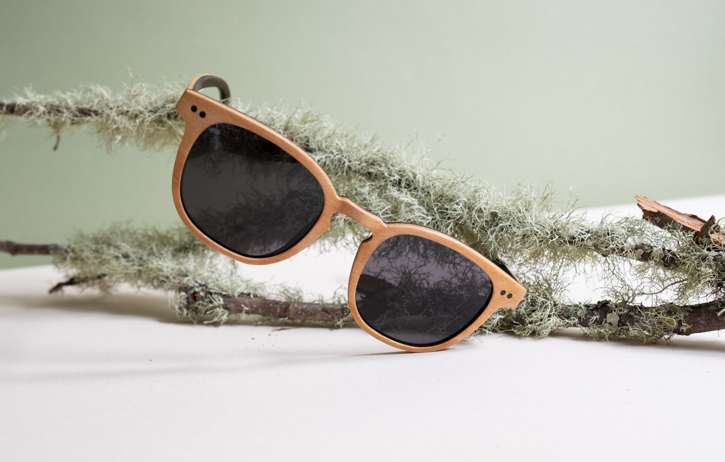 Our bamboo frames are light, sporting unique wooden grains.