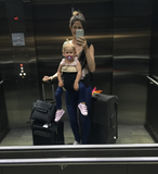 Mum with baby in baby carrier with luggage