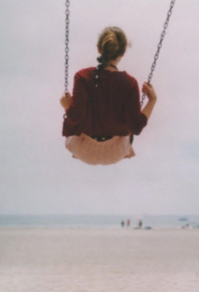 Girl On Swing at the beach