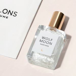 Wolf Moon Perfume - embrace your inner mystic with this sensual blend of vanilla and amber. The magic of Herkimer Diamond and Clear Quartz are included in each hand poured bottle of perfume.