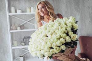 White Roses Wholesale Arrangement and Beautiful Woman