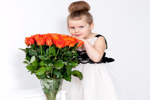 Little Girl Holds Orange Roses Bouquet