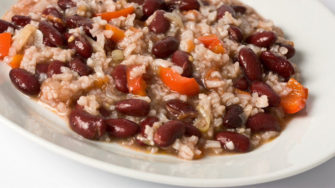 White rice with red beans on a white oval plate