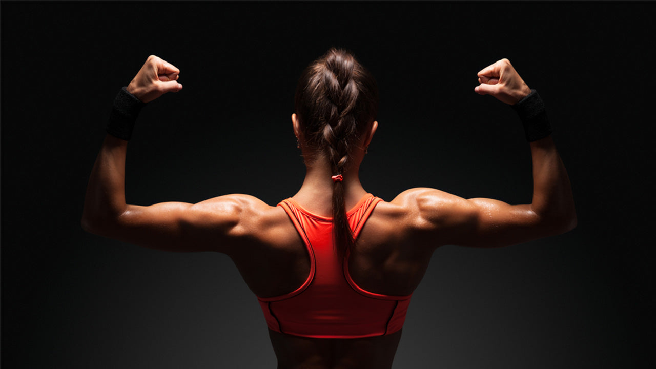 woman flexing back muscles