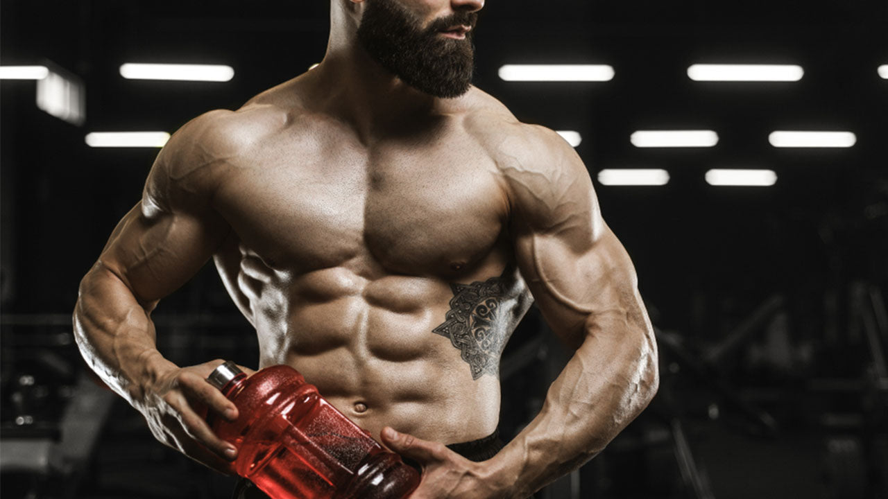 muscular man taking amino acids