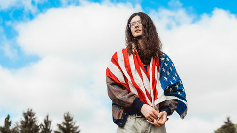 A man in American flag for celebrating Independence day- July 4th