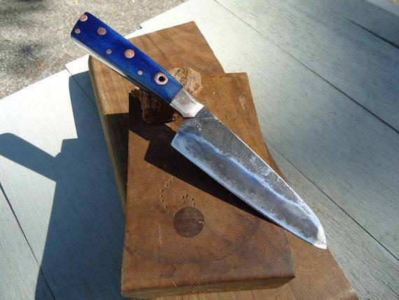 Hand-forged Japanese steel chef knife with blue bone handle custom made by Laevi Susman Metals Artisan