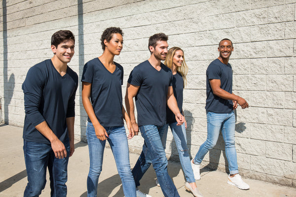 group of friends walking together wearing classic t shirts
