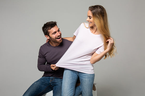 Happy couple wearing durable T-shirts