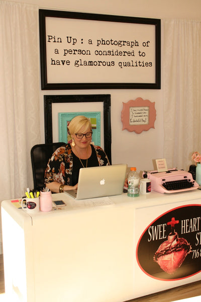 Destiny behind the desk at Sweetheart Pin Up Studio