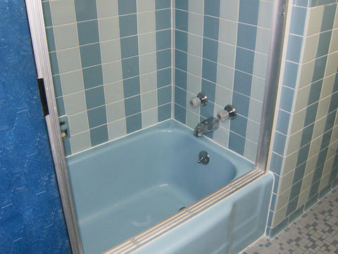 A retro renovation, save the blue bathroom. Tiled bathtub area