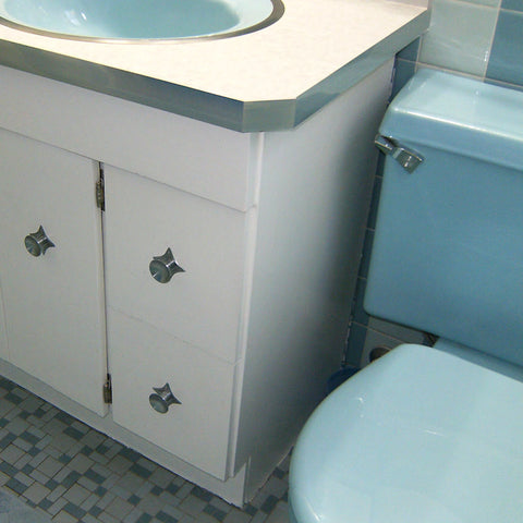 A retro renovation, save the blue bathroom. Blue toilet, starburst hardware and cabinet